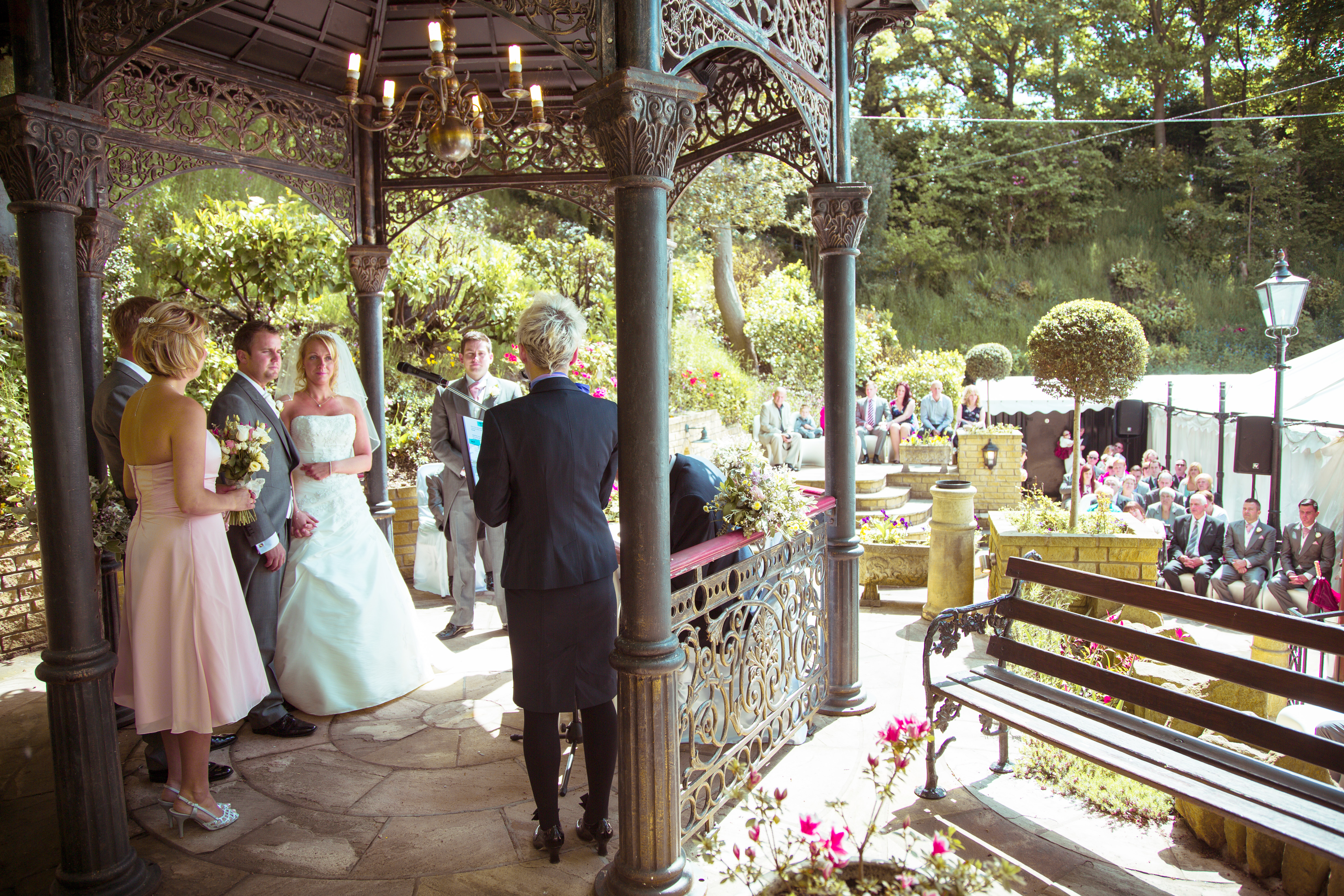 Signing the register - Grimscote manor outdoor wedding